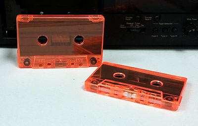 Fluorescent orange tinted cassette