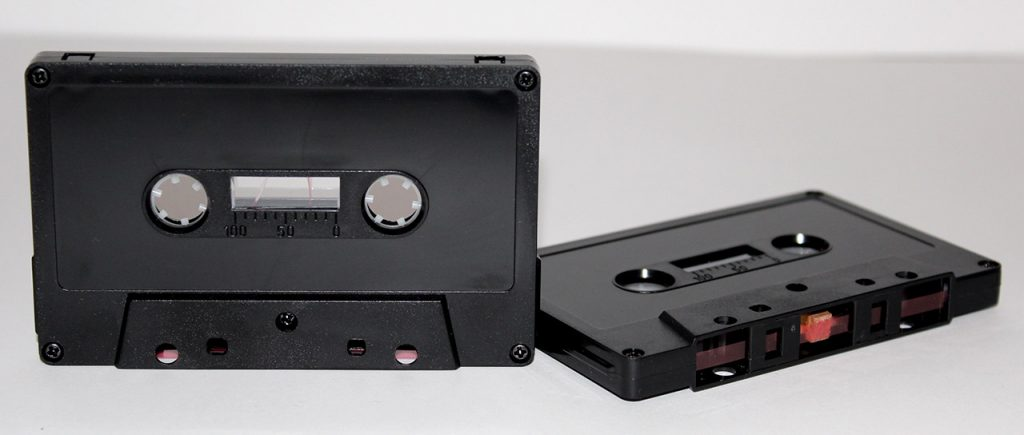 Tab-in black cassette shells from Duplication.ca