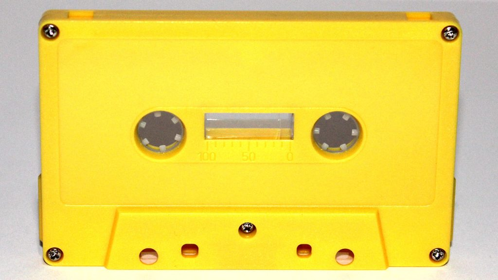Yellow cassette tape shell by Duplication.ca