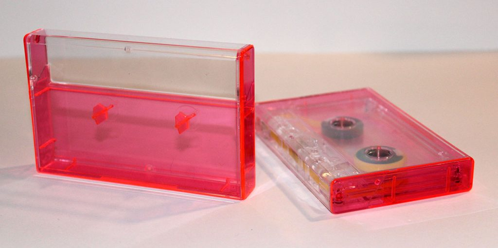 Neon Pink Norelco cassette case from Duplication.ca