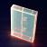 Florescent orange cassette box under blacklight