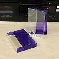 Audio Cassette Norelco Case With a Tinted Purple Back